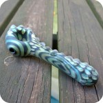 Five inch long full color sandblasted glass piece with a bumpy matte texture