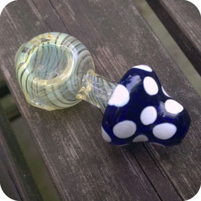 Spotted mushroom-shaped glass pipe with a silver fumed bowl and a flattened end, allowing it to stand firmly upright, like a real mushroom.