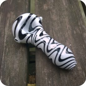 Black and white wig wag glass pipe with clear beads down the chamber