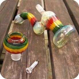 Silver fumed glass concentrate bubbler with Rastafarian themed green, yellow, and red stripes. Comes with glass nail and dome.