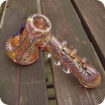 Hammer style glass bubbler with gold fuming, inside out designs, and glass wrapped around the stem