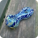 Short silver fumed glass pipe with blue and white inside-out designs and a donut-hole shaped mouthpiece