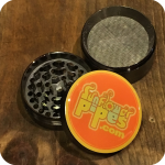Four Pieced Grinder With Sunflower Pipes Logo